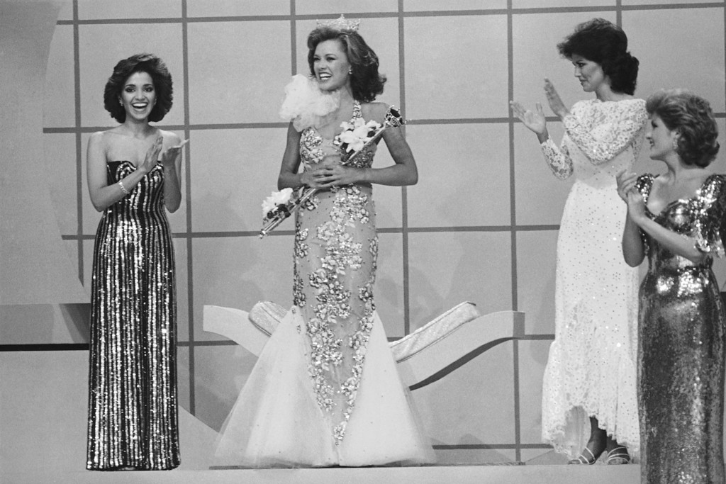 . Suzette Charles, Miss New Jersey, the first runner up, applauds the newly crowned Miss America, Vanessa Williams, Sept. 17, 1983 in Atlantic City. It is the first time there have been two blacks in that position. (AP Photo)