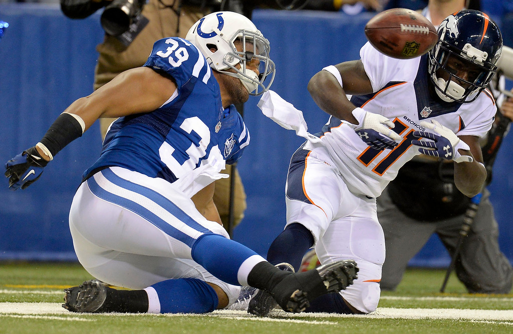 . Indianapolis Colts fullback Stanley Havili (39) strips the ball away from Denver Broncos wide receiver Trindon Holliday (11) during a punt return in the first quarter October 20, 2013 at Lucas Oil Field. The ball was recovered by the Colts. (Photo by John Leyba/The Denver Post)