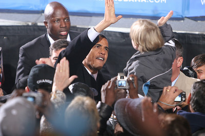 Barack High Fives Kid in Crowd