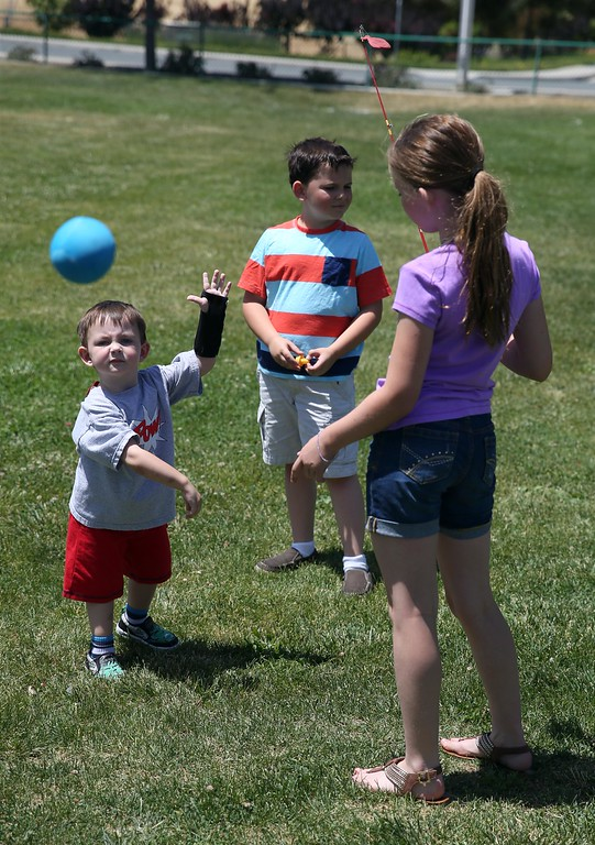 . Matthew Ouimet, 3, plays with his sister Molly, 11, right, and brother Patrick, 9, center, at Markley Creek Park in Antioch, Calif., on Thursday, May 22, 2014.  (Jane Tyska/Bay Area News Group)