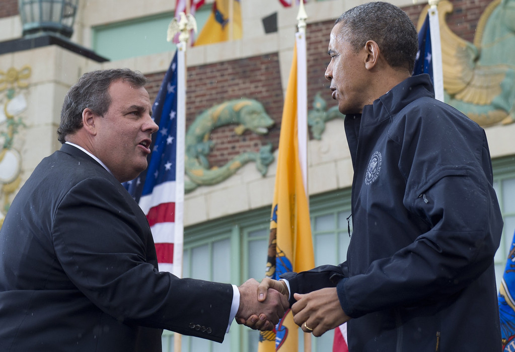 . US President Barack Obama shakes hands with New Jersey Governor Chris Christie (L) before speaking about rebuilding efforts following last year\'s Hurricane Sandy at the Asbury Park Convention Hall in Asbury Park, New Jersey, on May 28, 2013.    AFP PHOTO / Saul LOEB/AFP/Getty Images