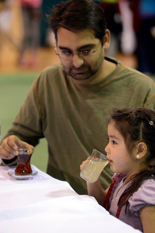 . DENVER, CO. - JANUARY 27: Sofia Yelton 4-years-old taste tea from Turkey with her dad james Yelton 36-years-old during the World Tea Fair at Denver Montclair International School January 27, 2013. There were 12 tables featuring tea samples from around the World.(Photo By John Leyba / The Denver Post)