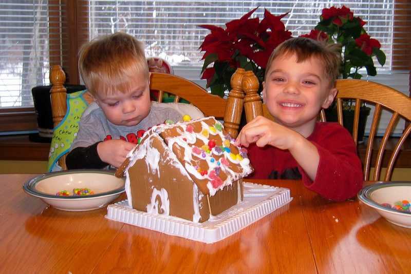 The ginger bread house construction is a fun activity on a snow day from school.