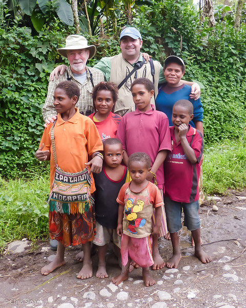 Chris Sloan and John Noel with children of Alua Kambe near Ambua Lodge, Papua New Guinea (10-04-2013).jpg