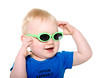 Cute baby boy with green sunglasses