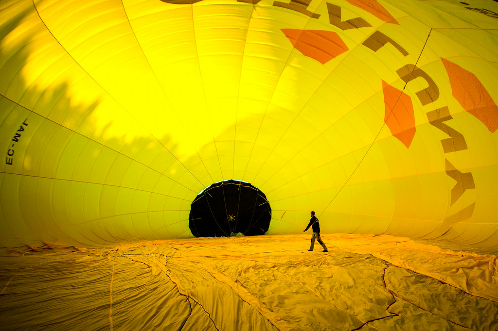 . A hot air balloon is inflated at the European Balloon Festival on July 10, 2014 in Igualada, Spain. The early morning flight of over 30 balloons was shorter than expected due to windy weather.  (Photo by David Ramos/Getty Images)