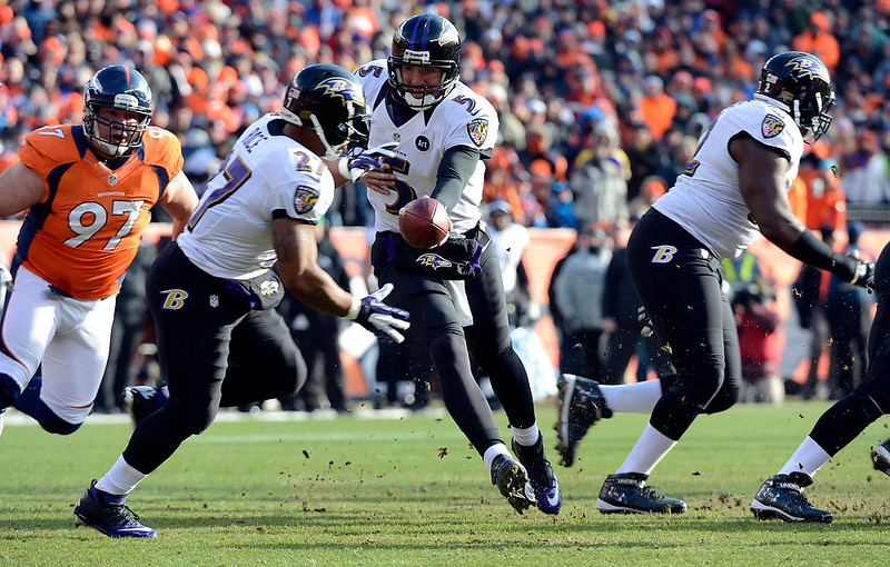 . Baltimore Ravens quarterback Joe Flacco (5) hands off to Baltimore Ravens running back Ray Rice (27) early in the first quarter.  The Denver Broncos vs Baltimore Ravens AFC Divisional playoff game at Sports Authority Field Saturday January 12, 2013. (Photo by John Leyba,/The Denver Post)
