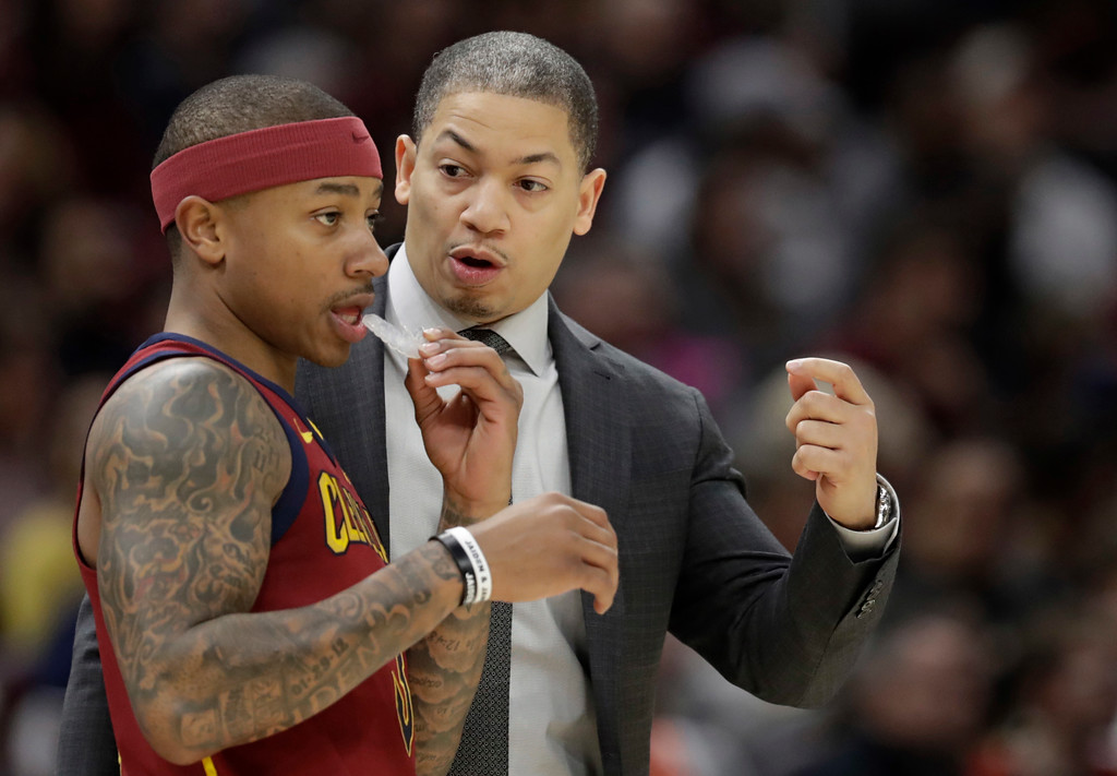 . Cleveland Cavaliers head coach Tyronn Lue, right, talks with Isaiah Thomas in the first half of an NBA basketball game against the Detroit Pistons, Sunday, Jan. 28, 2018, in Cleveland. The Cavaliers won 121-104. (AP Photo/Tony Dejak)