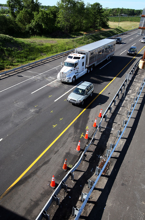 . Traffic moves pass the scene of a serious accident at milepost 71 on the northbound lanes of New Jersey Turnpike on Saturday, June 7, 2014 near Cranbury, N.J. Comedian Tracy Morgan is in critical condition following an early morning accident on the New Jersey Turnpike. The comedian was injured in a crash involving six vehicles that left at least one person dead and several others, including Morgan, with serious injuries.   (AP Photo/David Gard)