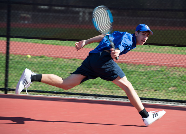 04/16/19 Wesley Bunnell | Staff Bristol Eastern boys tennis at Berlin on Tuesday afternoon. Bristol Eastern's Benjamin Chiasson.
