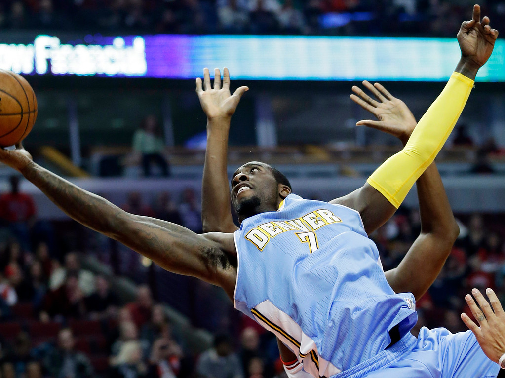 . Chicago Bulls center Nazr Mohammed (48), back, fouls Denver Nuggets forward JJ Hickson (7) during the first half of an NBA preseason basketball game in Chicago on Friday, Oct. 25, 2013. (AP Photo/Nam Y. Huh)