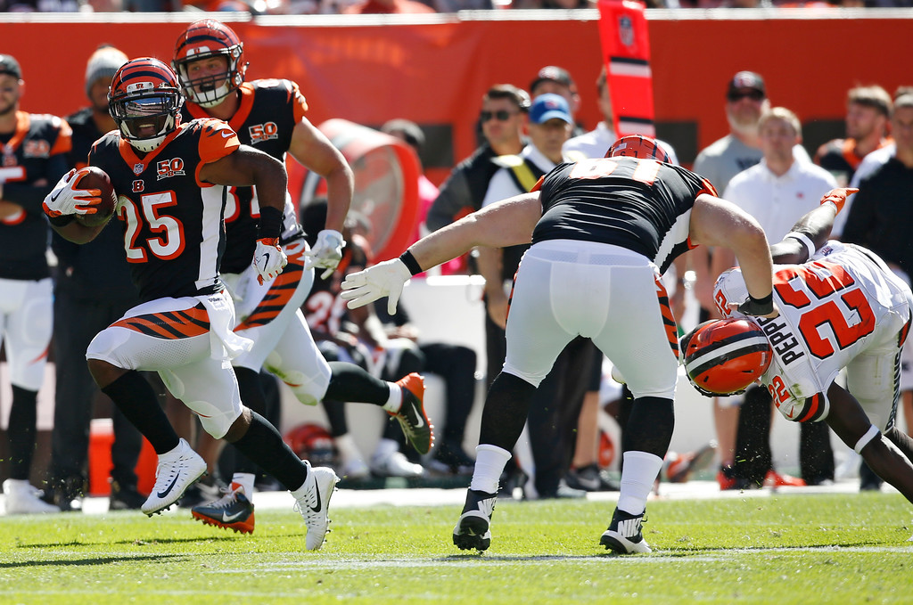 . Cincinnati Bengals running back Giovani Bernard (25) runs for a 61-yard touchdown in the first half of an NFL football game against the Cleveland Browns, Sunday, Oct. 1, 2017, in Cleveland. (AP Photo/Ron Schwane)