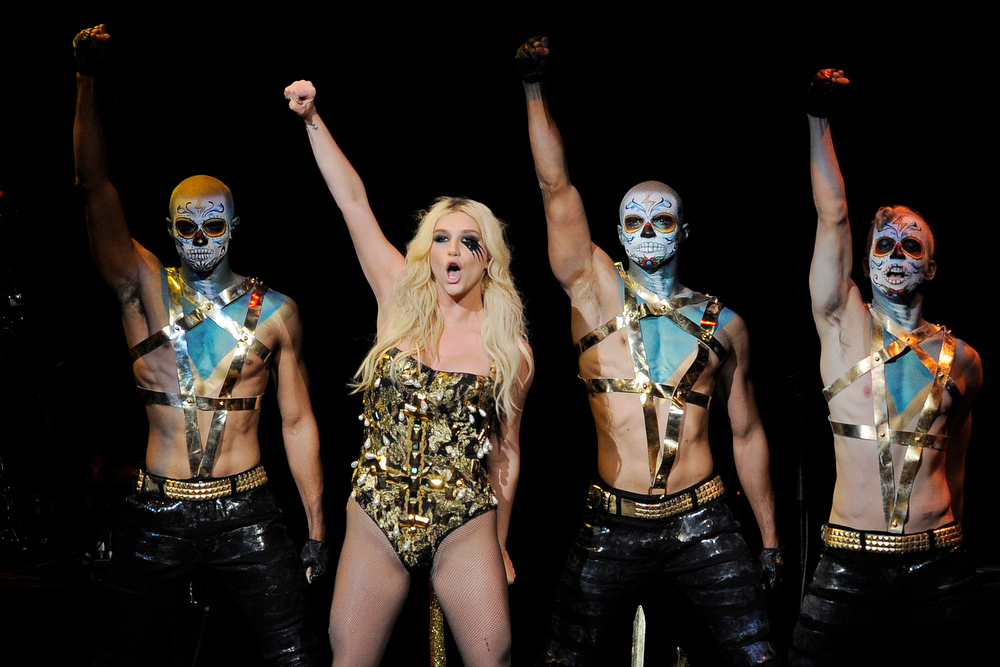 Description of . Ke$ha, second from left, performs with backup dancers during the second night of KIIS FM's Jingle Ball at Nokia Theatre LA Live on Monday, Dec. 3, 2012, in Los Angeles. (Photo by Chris Pizzello/Invision/AP)