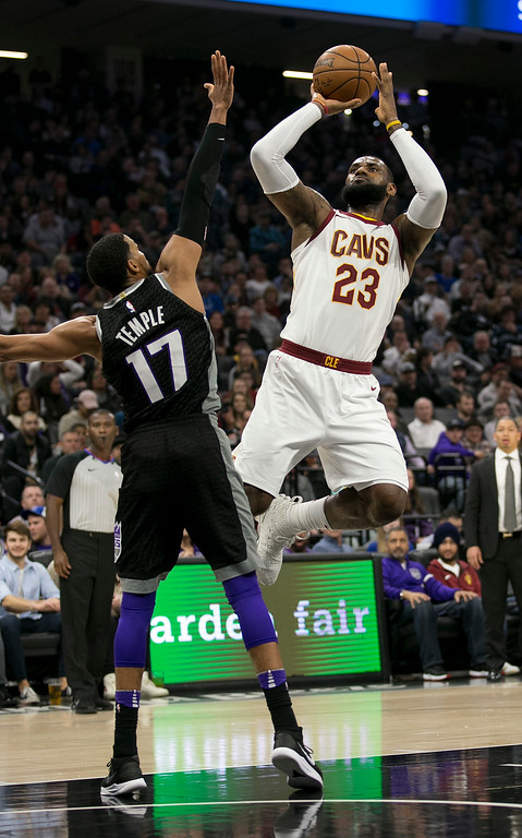 . Cleveland Cavaliers forward LeBron James, right, shoots over Sacramento Kings guard Garrett Temple during the first quarter of an NBA basketball game, Wednesday, Dec. 27, 2017, in Sacramento, Calif. (AP Photo/Rich Pedroncelli)