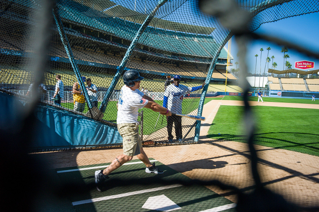 . US servicemen get to take batting practice at Dodger Stadium during Veterans Day at Dodger Stadium Monday, November 11, 2013.  The dodgers hosted 100 active duty and retired military to Dodger Stadium to take part in batting practice, enjoy and Dodger lunch and tour the facilities.    ( Photo by David Crane/Los Angeles Daily News )