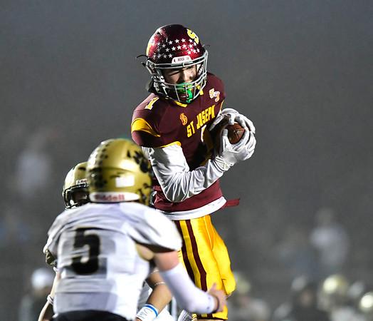 12/14/2019 Mike Orazzi | StaffrSt. Joseph High School's Brady Hutchison (1) hauls in a pass during a 17-13 win over Daniel Hand at Veteran's Stadium in New Britain on Saturday. ?