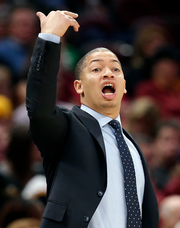 . Cleveland Cavaliers coach Tyronn Lue yells instructions to players during the second half of an NBA basketball game against the Philadelphia 76ers, Saturday, Dec. 9, 2017, in Cleveland. The Cavaliers won 105-98. (AP Photo/Tony Dejak)