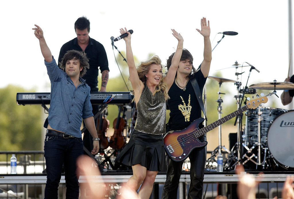 . (L-R) Musicians Neil Perry, Kimberly Perry, and Reid Perry of The Band Perry perform onstage during the iHeart Radio Music Festival Village on September 21, 2013 in Las Vegas, Nevada.  (Photo by Isaac Brekken/Getty Images for Clear Channel)