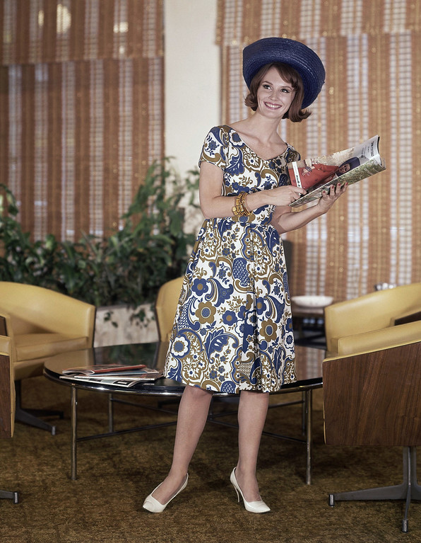 . Predominantly blue dress with other colors with blue hat and white shoes fashion dress in 1963. (AP Photo)