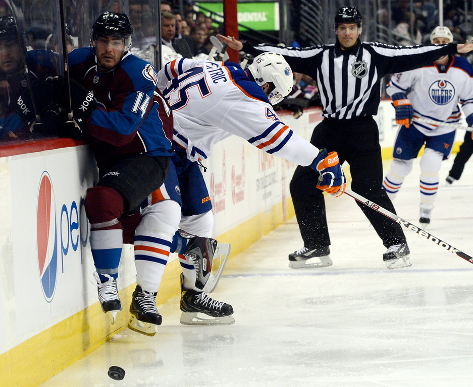 . DENVER, CO. - FEBRUARY 2ND: David Van Der Gulik, Colorado Avalanche, left, crashes into the boards along with Mark Fistric, Edmonton Oilers in pursuit of the puck in the first period of play at the Pepsi Center in Denver Colorado, February 2nd, 2013.  (Photo By Andy Cross / The Denver Post)