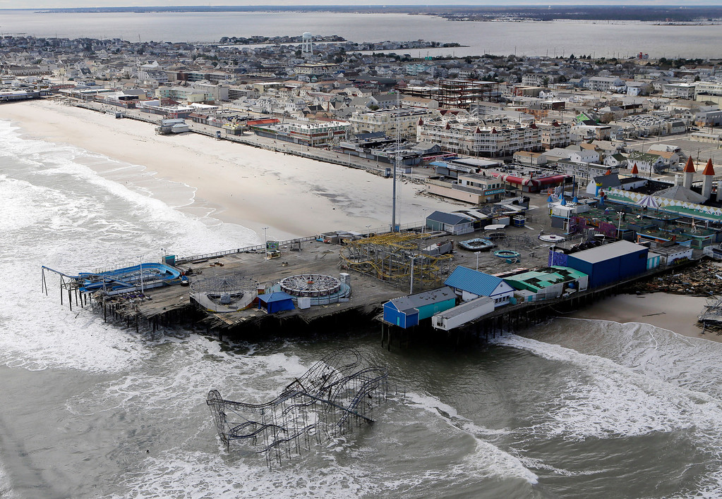 . This Oct. 31, 2012 file aerial photo shows the damage to an amusement park in Seaside Heights, N.J., after Superstorm Sandy.  A massive fire raging for hours Thursday, Sept. 12, 2013, burned several blocks of a boardwalk and businesses in Seaside Heights, N.J. (AP Photo/Mike Groll, File)