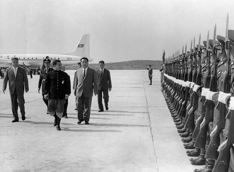 . In this October 4, 1965 photo from North Korea\'s official Korean Central News Agency, distributed by Korea News Service, Norodom Sihanouk, king of Cambodia, arrives in Pyongyang Airport (Sunan International Airport) and inspects together with Leader Kim Il Sung the land, sea and air forces of North Korean People\'s Army Honor Guard. (Korean Central News Agency/Korea News Service via AP Images)