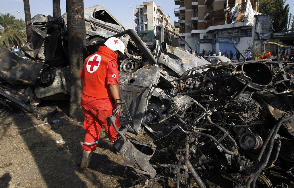 . A member of the Lebanese Red Cross inspects the site of a blast outside the Al-Taqwa mosque in the northern city of Tripoli on August 23, 2013. AFP PHOTO/ANWAR  AMRO/AFP/Getty Images