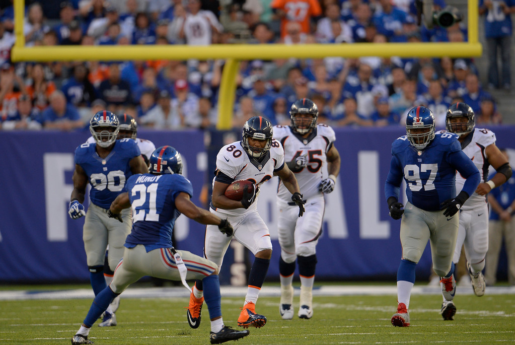 . At the 2-minute warning in the first half tight end Julius Thomas (80) of the Denver Broncos gains 19 yards with a catch and run against the New York Giants at METLIFE Stadium. September 15, 2013 East Rutherford, NJ. (Photo By Joe Amon/The Denver Post)