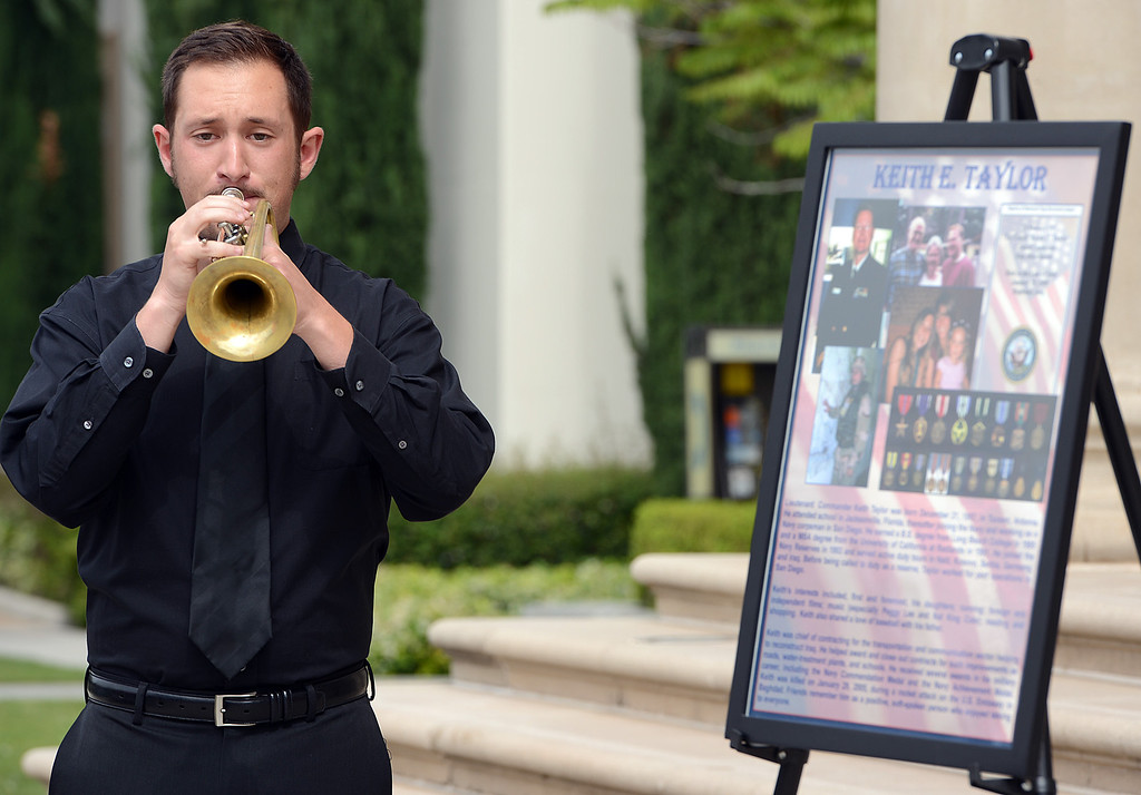 . Matthew Busch, a Masters student in Performance, plays taps during a memorial service for fallen service members was held Friday May 17, 2013 in front of the Memorial Chapel at the university. The ceremony featured a special tribute to Keith Taylor, a University of Redlands alumnus and father of a University of Redlands student. He was killed serving in Iraq. (Rick Sforza/Staff photographer, Redlands Daily Facts)