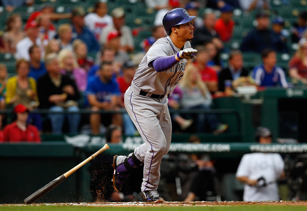 . ARLINGTON, TX - MAY 08:  Nolan Arenado #28 of the Colorado Rockies hits a single to center field against the Texas Rangers in the top of the third inning at Globe Life Park in Arlington on May 8, 2014 in Arlington, Texas.  (Photo by Tom Pennington/Getty Images)