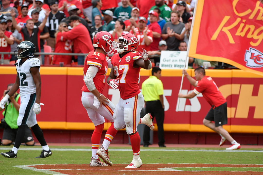 . Kansas City Chiefs running back Kareem Hunt (27) celebrates with quarterback Alex Smith (11), after scoring a touchdown, during the second half of an NFL football game against the Philadelphia Eagles in Kansas City, Mo., Sunday, Sept. 17, 2017. (AP Photo/Ed Zurga)