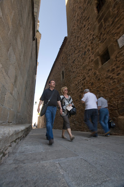 Visitors on a narrow street, Caceres, Spain