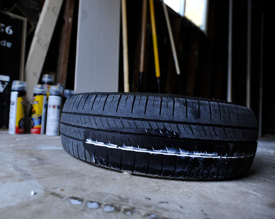 . Cans of Fix-A-Flat can be seen in the background where a motorist tried to repair a slashed tire along Glazier Drive in Concord, Calif., on Monday, Feb. 11, 2013. (Susan Tripp Pollard/Staff)