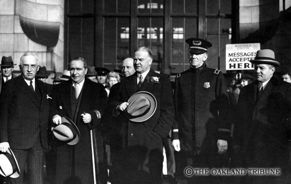 . Oakland, CA November 8, 1932 - Businessman Marshal Hale, Secretary of the Treasury Ogden L. Mills, President Herbert Hoover, Oakland Chief of Police Jas Drew, and presidential secretary Lawrence Rickey at the Sixteenth Street Southern Pacific Depot. (Oakland Tribune Staff Archives)
