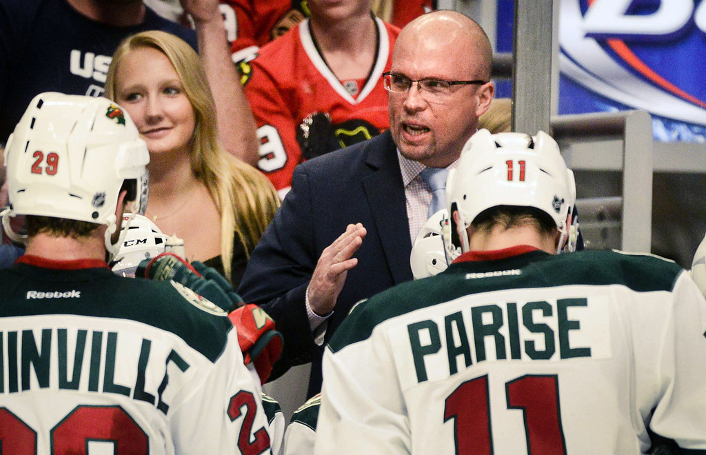 . Wild head coach Mike Yeo speaks to his players during the second period against the Blackhawks.  (Pioneer Press: Ben Garvin)
