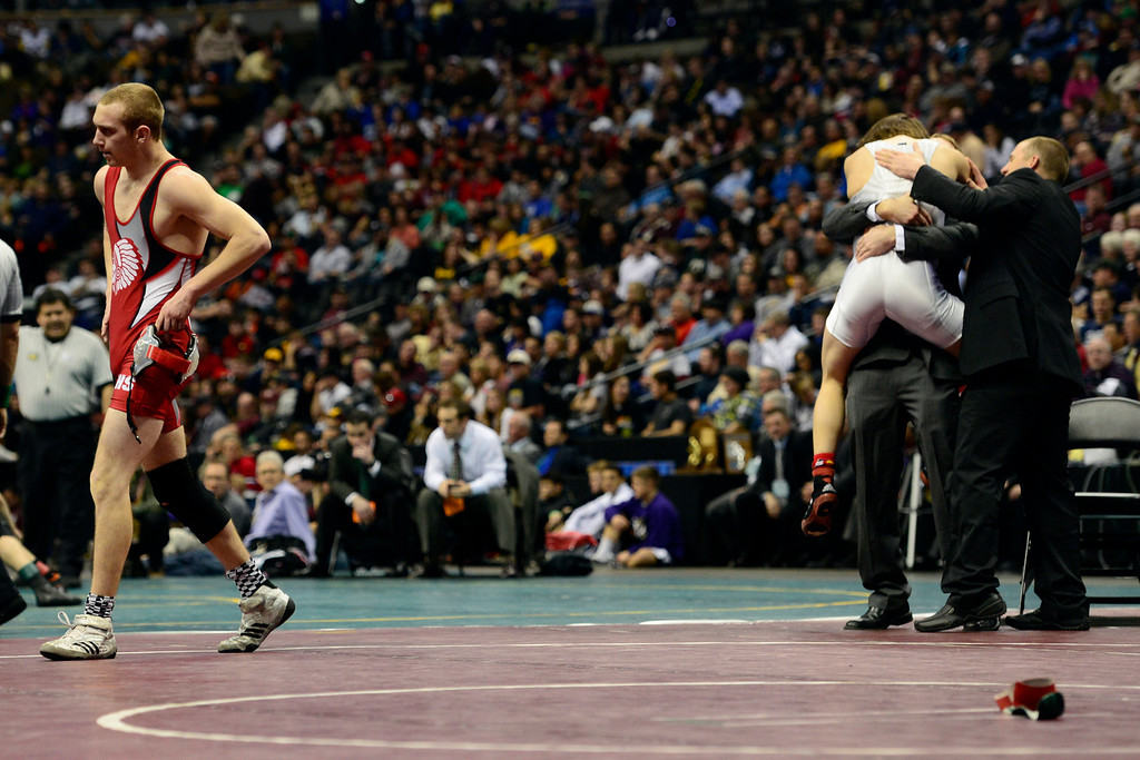 . DENVER, CO - FEBRUARY 23: Highland 138-pounder Kris Trujillo celebrates his 8-0 win against La Veta 138-pounder W.D. Arnold in the class 2A final during the Colorado State High School Wrestling Championships. The state\'s top wrestlers squared off in four classes in front of a near-capacity crowd at the Pepsi Center. (Photo by AAron Ontiveroz/The Denver Post)