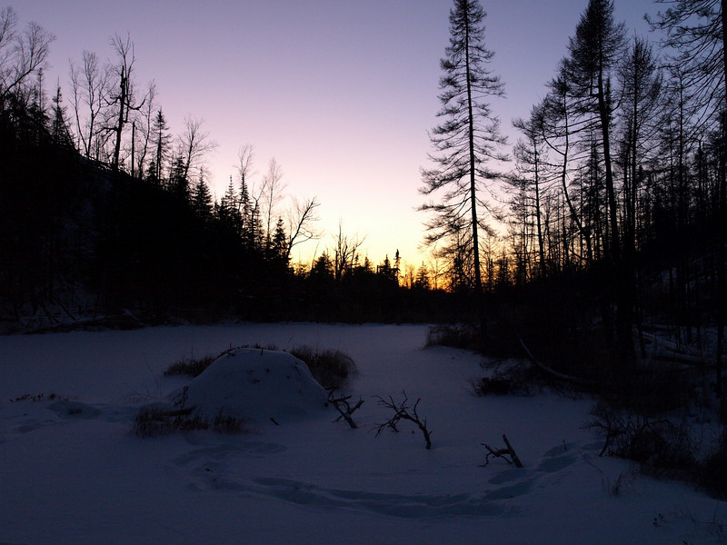"""Another BWCA allure.   In foreground is the beaver lodge and to the left of it I went into the drink earlier on.  Up to my...  Lot's of excitement on short notice.  In retrospect, I should have stopped and put on dry socks right away instead of hiking another mile in icy-water logged sorel boots.    """"Accomplish the mission first, then get the people out,"""" OK, so I got frost bite and damaged some tissue on my feet, but we got the Kekekabic Trail cleared that day...."""