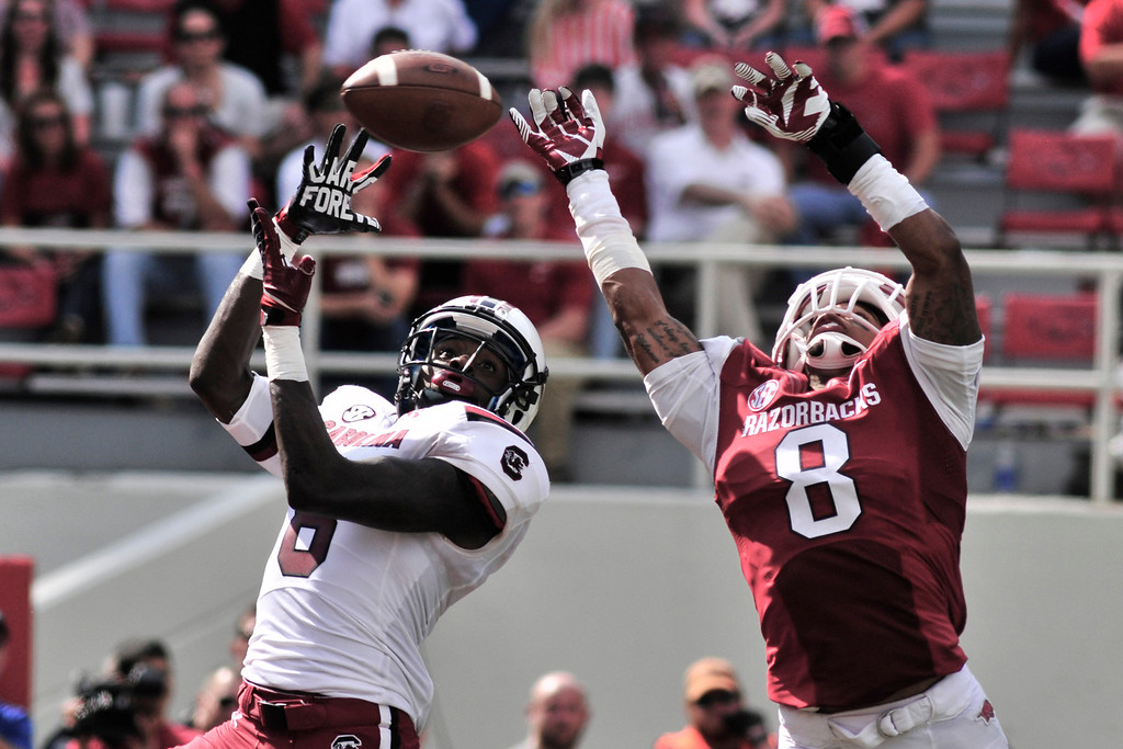. Arkansas cornerback Tevin Mitchel (8) deflects a pass intended for South Carolina wide receiver Shamier Jeffery during the second half of an NCAA college football game in Fayetteville, Ark., Saturday, Oct. 12, 2013. South Carolina defeated Arkansas 52-7. (AP Photo/April L Brown)