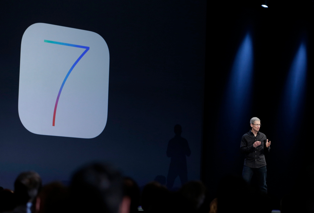 . Apple CEO Tim Cook speaks about the new iOS 7 during the keynote address of the Apple Worldwide Developers Conference Monday, June 10, 2013, in San Francisco. (AP Photo/Eric Risberg)
