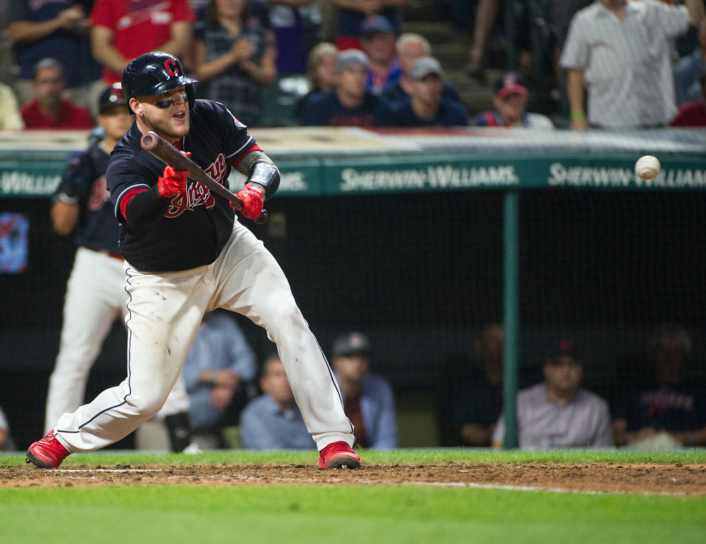 . Cleveland Indians\' Roberto Perez prepares to bunt a pitch from Boston Red Sox relief pitcher Brandon Workman during the ninth inning of a baseball game in Cleveland, Monday Aug. 21, 2017. The bunt allowed teammate Brandon Guyer to score the winning run from second base after a throwing error by Red Sox\' Brock Holt. The Indians won 5-4. (AP Photo/Phil Long)