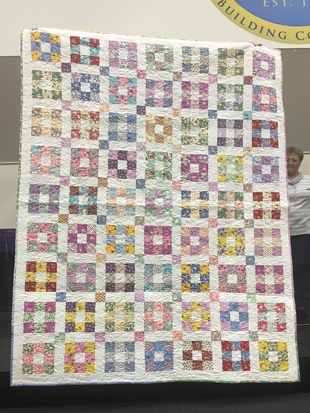 Quilt pattern is Hopscotch.  quilt made by John Putnam