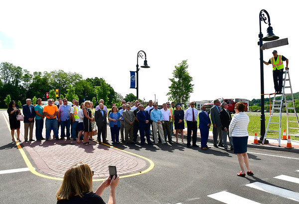 6/7/2019 Mike Orazzi | Staff Bristol DPW's Peter English unveils the new sign for Hope Street in downtown Bristol on Friday morning.