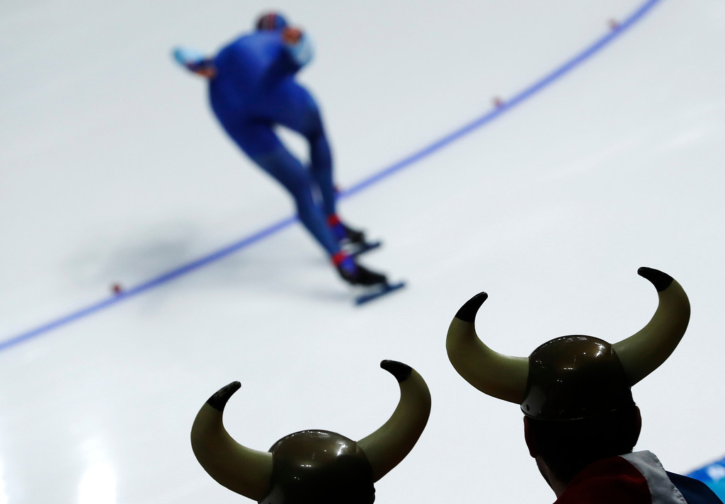 . Two spectator dressed as Vikings watch as Havard Lorentzen of Norway competes during the men\'s 1,000 meters speedskating race at the Gangneung Oval at the 2018 Winter Olympics in Gangneung, South Korea, Friday, Feb. 23, 2018. (AP Photo/John Locher)