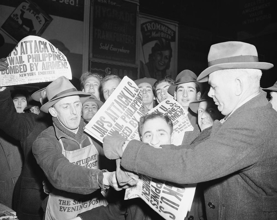 . Selling papers  on Dec. 7, 1941 at Times Square in New York City, announcing that Japan has attacked U.S. bases in the Pacific. (AP Photo/Robert Kradin)