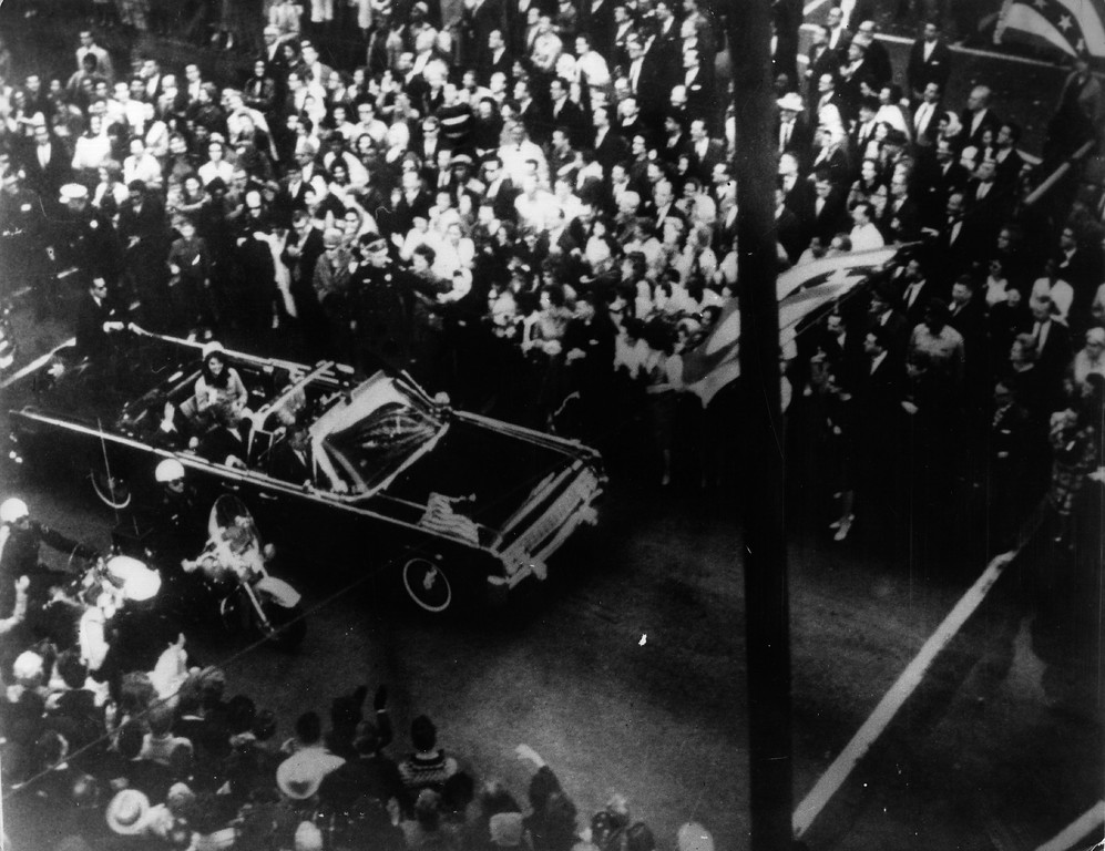 . Crowds cheer the presidential motorcade before the assassination.  Keystone/Getty Images