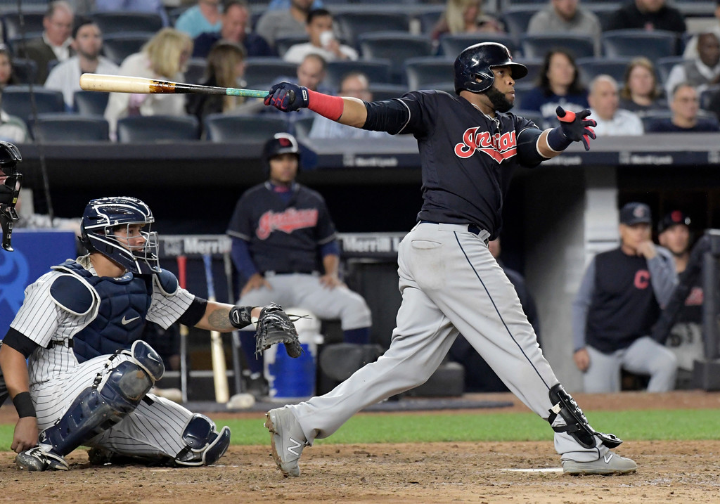 . Cleveland Indians\' Carlos Santana hits a home run as New York Yankees catcher Gary Sanchez, left, looks on during the seventh inning of a baseball game, Monday, Aug. 28, 2017, at Yankee Stadium in New York. (AP Photo/Bill Kostroun)