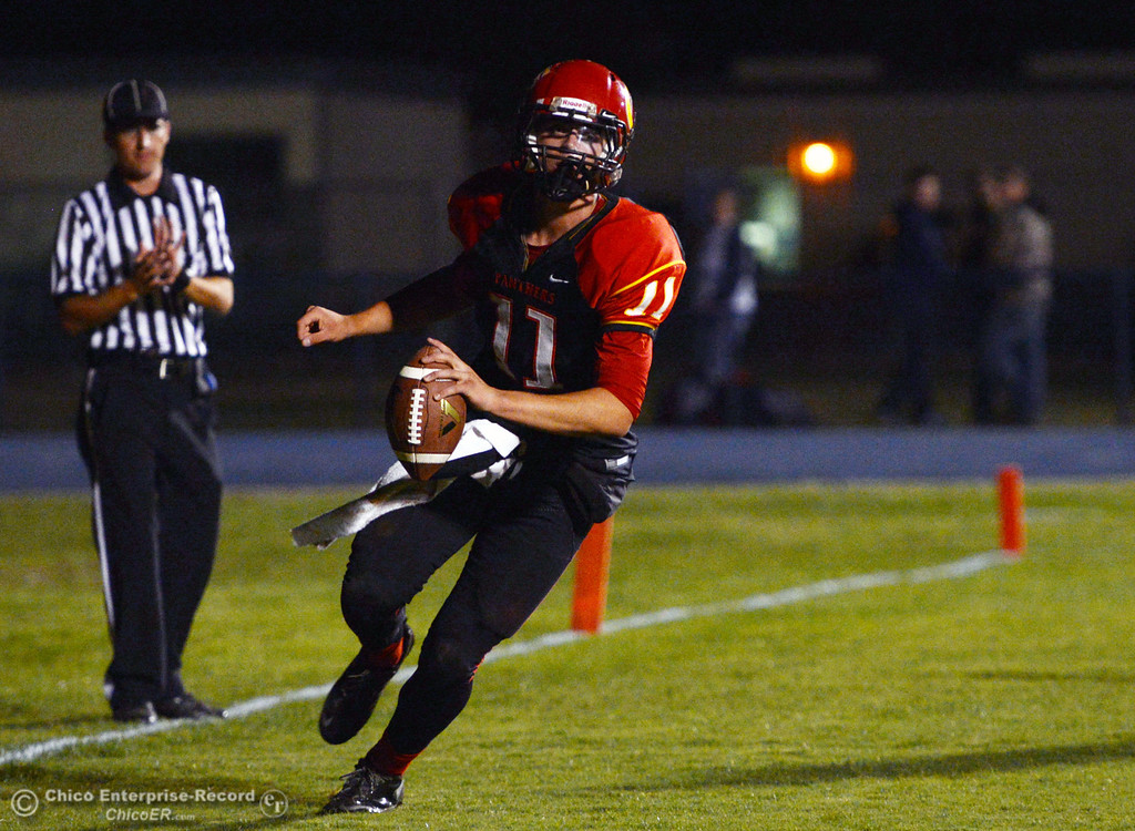 . Chico High\'s #11 Clayton Welch runs in for a touchdown against Central Valley High in the first quarter of their football game at Asgard Yard Friday, September 27, 2013, in Chico, Calif.  (Jason Halley/Chico Enterprise-Record)