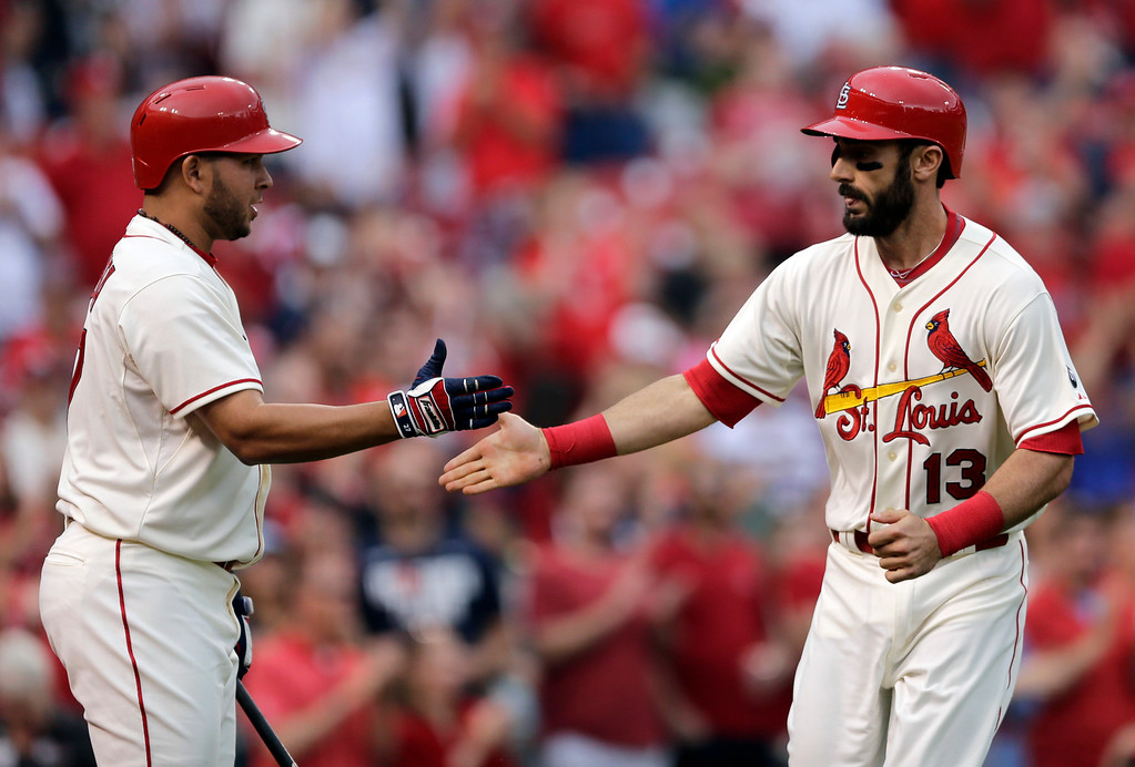 . St. Louis Cardinals\' Matt Carpenter, right, is congratulated by teammate Jhonny Peralta after hitting a solo home run during the first inning of a baseball game against the Detroit Tigers, Saturday, May 16, 2015, in St. Louis. (AP Photo/Jeff Roberson)