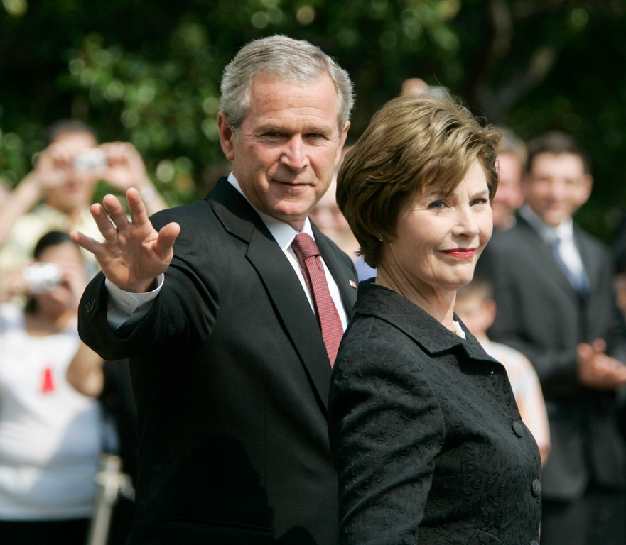 . President Bush, left, waves as he walks with first lady Laura Bush before their departure on the South Lawn of the White House, Sunday, Sept. 10, 2006 in Washington. Bush is traveling to New York to attend a wreath laying ceremony commemorating the fifth anniversary of Sept. 11, 2001. (AP Photo/Pablo Martinez Monsivais)