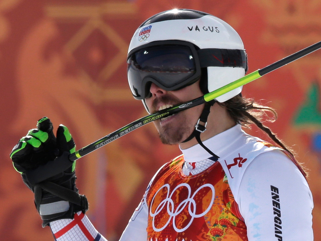 . Czech Republic\'s Ondrej Bank bites his ski pole after finishing the second run of the men\'s giant slalom at the Sochi 2014 Winter Olympics, Wednesday, Feb. 19, 2014, in Krasnaya Polyana, Russia. (AP Photo/Gero Breloer)